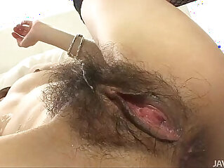 Japanese doll Sara has her furry muff pounded by a hard black dick
