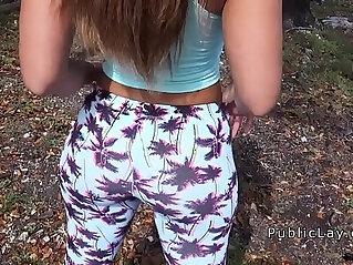 Latina babe in legging shaking booty in public