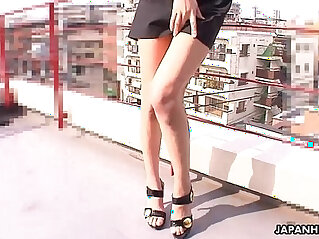 Stuffing her pussy with a toy on the rooftop