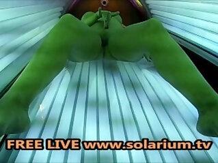 Horny Milf fingering and masturbating in the public solarium spy Hidden Cam