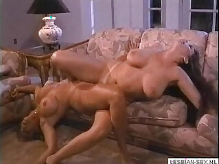 Blonde brunette lesbians suck and rub pussies together on couch Get CAMS of girls like this o