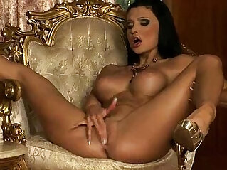 Nude tan skin brunette beauty Aletta Ocean strokes her bald pussy and shows off her round tits